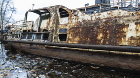 Abandoned rusty ship in polluted river. Abandoned rusty ship and trash in polluted river Royalty Free Stock Photography