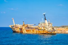 Abandoned rusty ship wreck EDRO III in Pegeia, Paphos, Cyprus. royalty free stock image