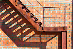 Abandoned rusty staircase and shadow stock image