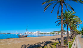 Abandoned sail boat on the beach.  Mid morning sun on Ibiza waterfront.  Warm sunny day along the beach in St Antoni de Portmany. Stock Photography