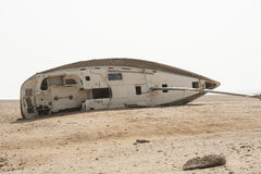 Abandoned sailing yacht in the desert Stock Image