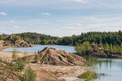 Abandoned sand quarry to the blue lake Stock Photo