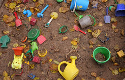 Abandoned sandbox. Forgotten toys in a dirty sandbox. Depressive mood stock image