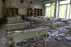Abandoned school. Chernobyl disaster results. This is classroom in abandoned school in small city Pripyat (about 5 kilometers form the Chernobyl nuclear station Stock Photo