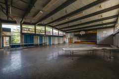 Abandoned School Cafeteria and Stage Stock Photos