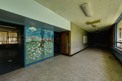 Abandoned School Hallway with Mural Royalty Free Stock Photo