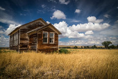Abandoned school house in the Montana Badlands Royalty Free Stock Photography