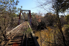 Abandoned Seaboard System Railroad Bridge. Abandoned Pratt through truss bridge over Pea River on Seaboard System Railroad in South Alabama Stock Photography