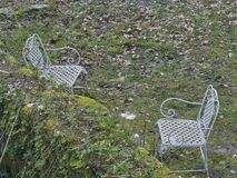 Abandoned seat in the garden Stock Images