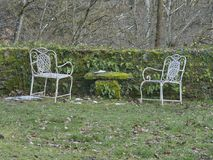 Abandoned seat in the garden Royalty Free Stock Images
