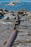 Abandoned Sewage pipe line. On Jennycliff beach Plymouth leading into the sound Royalty Free Stock Photos