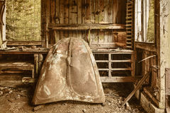 Abandoned shed in a forest. Abandoned shed with a rusted car hood in a forest Royalty Free Stock Photography