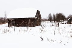 Abandoned shed in old russian village in winter. Abandoned shed in old russian village in overcast winter day in little village in Smolensk region of Russia Royalty Free Stock Images