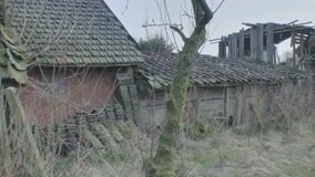 Abandoned Shed with a Stock Pile of Roof Tiles stock video footage