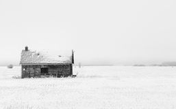 Abandoned shed  in winter landscape Stock Photo
