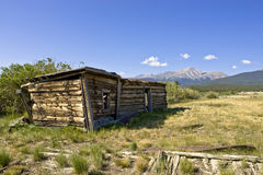 Abandoned Shelter at Base of Mt. Massive. Shelter of large wood timbers at base of Mount Massive in Leadville, Colorado, United States Stock Image