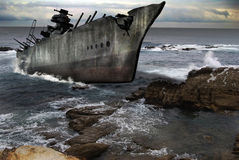 Abandoned ship. A big military ship abandoned in the sea coast. 3D composition Stock Images