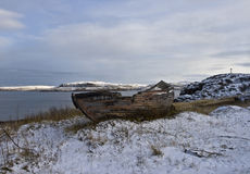 Abandoned ship. Old abandoned boat in Kola Peninsula close to Barents Sea (Russia Stock Photography