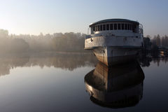 Abandoned ship. Abandoned and broken ship in morning haze. Copyspace provided Royalty Free Stock Photos