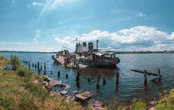 Abandoned ship in the bay on a summer day