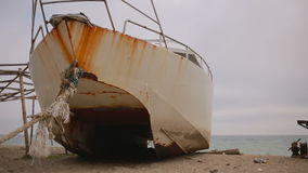 Abandoned ship on the beach, concept of ecology stock footage