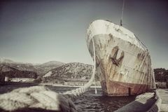 Abandoned ship at the harbor stock photo
