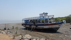 Abandoned Ship. At low tide in Elefanta Island, India. Desert landscape Stock Images