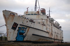 Abandoned ship,. Once important passenger ship put in dry dock to become a canvas for graffity artists to show of there talents,to all that pas her or to visit Stock Image