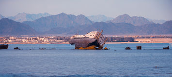 Abandoned ship in the sea. Abandoned broken ship in the sea , landscape royalty free stock photos