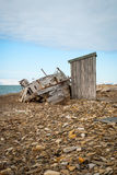 Abandoned ship on the shore in Svalbard Stock Photo
