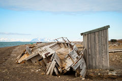 Abandoned ship on the shore in Svalbard Stock Photos