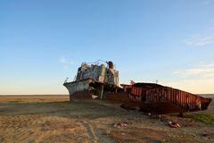 Abandoned ships Aral Sea. The Aral Sea is a formerly un salt lake in Central Asia. The Aral Sea was an endorheic lake lying between Kazakhstan in the north and Royalty Free Stock Image