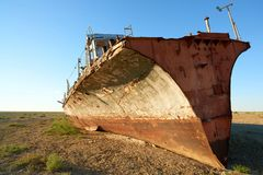 Abandoned ships Aral Sea. The Aral Sea is a formerly un salt lake in Central Asia. The Aral Sea was an endorheic lake lying between Kazakhstan in the north and Royalty Free Stock Images