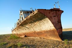 Abandoned ships Aral Sea. The Aral Sea is a formerly un salt lake in Central Asia. The Aral Sea was an endorheic lake lying between Kazakhstan in the north and Royalty Free Stock Photos