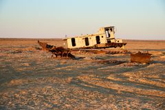 Abandoned ships Aral Sea. The Aral Sea is a formerly un salt lake in Central Asia. The Aral Sea was an endorheic lake lying between Kazakhstan in the north and Royalty Free Stock Photo