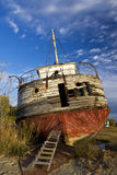Abandoned shipwreck ashore royalty free stock photography