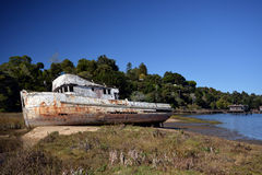 Abandoned shipwreck in the bay. Abandoned shipwreck in Tomales Bay, CA stock images