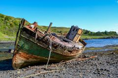 Abandoned shipwreck of an old fishing boat. royalty free stock photography