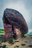 Abandoned shipwreck on shore in Fort William, Scotland, United Kingdom Stock Photography