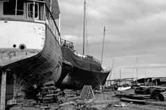Abandoned Shipyard. View of an abandoned shipyard with two broken boats on the side Stock Photography