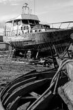Abandoned Shipyard. View of an abandoned shipyard with two broken boats Stock Images
