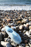 Abandoned shoe on beach royalty free stock photo
