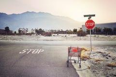 Abandoned shopping cart on a street at sunset, USA. Stock Photo