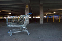 Abandoned shopping trolley in car park Stock Images
