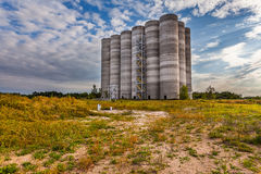 Abandoned silos at the port Royalty Free Stock Image