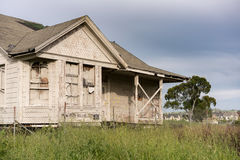 Abandoned single family home with wooden siding as fixer upper property Stock Photography