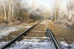Abandoned single track railway line in sunny freezing weather Royalty Free Stock Photos