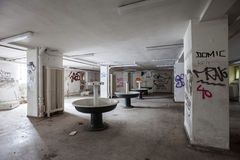 Abandoned sinks in basement Stock Photography