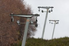 Abandoned ski lift masts with missing cable royalty free stock photography