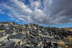 Abandoned slate mine. Wide angle view of abandoned slate mine waste royalty free stock images